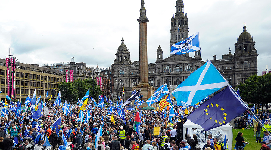 Pro-Scottish Independence supporters with Scottish Saltire flags and EU flags among others rally in George Square in Glasgow, Scotland on July 30, 2016 to call for Scottish independence from the UK © Andy Buchanan