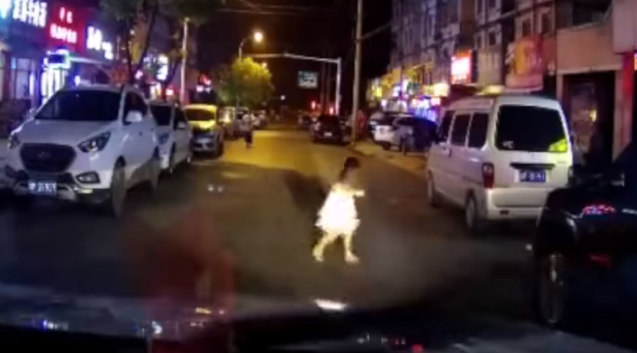 Young girl hit by car after running across road, walks away uninjured (SHOCKING VIDEO)