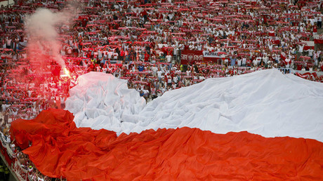 Poland's fans light a flare before match with Portugal © Eric Gaillard