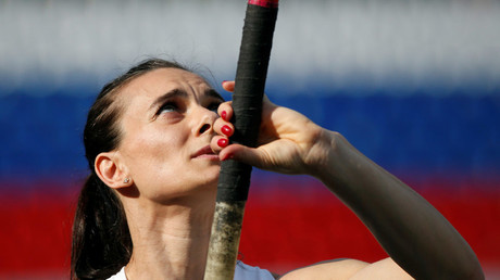 Russian pole vaulter Yelena Isinbayeva warms up. © Sergei Karpukhin