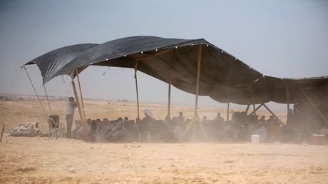 Bedouins attend Friday prayer under a tent in the Al-Araqib village, located between Beersheba and Rahat in the Israeli Negev desert. © Hazem Bader
