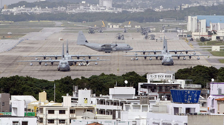 Hercules aircraft are parked on the tarmac at Marine Corps Air Station Futenma in Ginowan on Okinawa. © Issei Kato