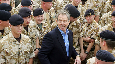 This file photo taken on December 22, 2005 shows British Prime Minister Tony Blair (C) with troops at Shaiba Logistics Base in Basra, Iraq. ©Adrian Dennis