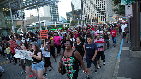 People rally in Dallas, Texas, on Thursday, July 7, 2016 to protest the deaths of Alton Sterling and Philando Castile © Laura Buckman