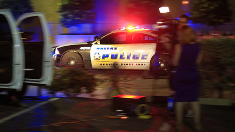 A Dallas police officer drives near the scene where eleven Dallas police officers were shot and five have now died on July 7, 2016 in Dallas, Texas. © Ron Jenkins
