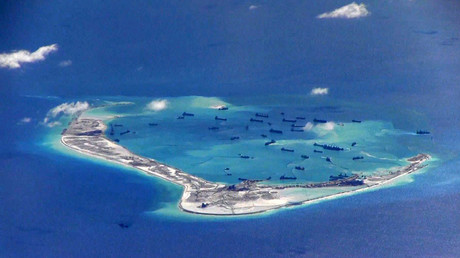 Chinese dredging vessels are purportedly seen in the waters around Mischief Reef in the disputed Spratly Islands in the South China Sea in this still image from video taken by a P-8A Poseidon surveillance aircraft provided by the United States Navy May 21, 2015. © U.S. Navy