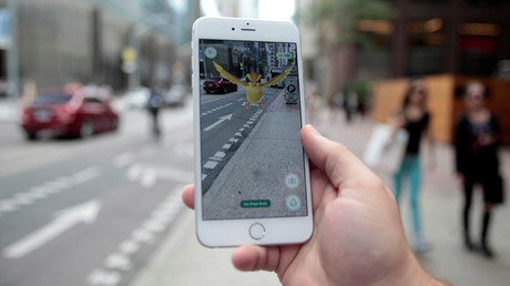 "A ""Pidgey"" Pokemon is seen on the screen of the Pokemon Go mobile app, Nintendo's new scavenger hunt game which utilizes geo-positioning, in a photo illustration taken in downtown Toronto, Ontario, Canada July 11, 2016 © Chris Helgren"