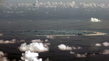 An aerial photo taken though a glass window of a Philippine military plane shows the alleged on-going land reclamation by China on mischief reef in the Spratly Islands in the South China Sea, west of Palawan, Philippines, May 11, 2015. ©Ritchie B. Tongo