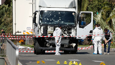 Investigators continue to work at the scene near the heavy truck that ran into a crowd at high speed killing scores who were celebrating the Bastille Day July 14 national holiday on the Promenade des Anglais in Nice, France, July 15, 2016. © Eric Gaillard