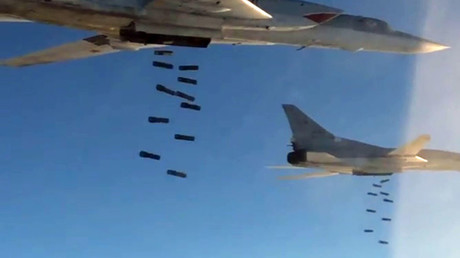 Long-distance supersonic Tu-22 M3 missile-carriers seen delivering an air strike at recently-detected ISIL targets in the Palmyra environment. ©