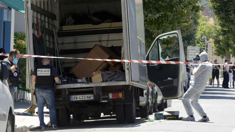 French investigating police conduct a search for clues around a truck, the day after a heavy a truck ran into a crowd at high speed killing scores and injuring more who were celebrating the Bastille Day national holiday, in Nice, France, July 15, 2016. © Jean-Pierre Amet