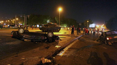 Damaged vehicles are seen in front of a military vehicle during an attempted coup in Ankara, Turkey July 16, 2016. © Stringer