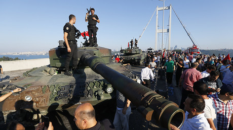 Policemen stand on a military vehicle after troops involved in the coup surrendered on the Bosphorus Bridge in Istanbul, Turkey, July 16, 2016 © Murad Sezer