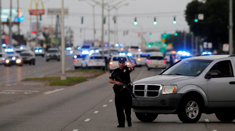 Police officers block off Airline Highway near the scene of a fatal shooting of police officers in Baton Rouge, Louisiana, United States, July 17, 2016. © Joe Penney