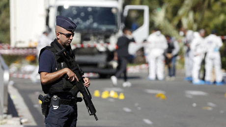 French police secure the area as the investigation continues at the scene near the heavy truck that ran into a crowd at high speed killing scores who were celebrating the Bastille Day July 14 national holiday on the Promenade des Anglais in Nice, France, July 15, 2016. © Eric Gaillard