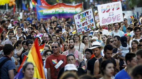FILE PHOTO: Participants of an annual gay pride parade march before an Orthodox Jewish assailant stabbed and injured six participants in Jerusalem © Amir Cohen