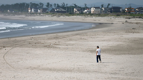 A man walks at the empty Yotsukura municipal beach in Iwaki, about 40 km (25 miles) south of the tsunami-crippled Fukushima Daiichi nuclear power plant, Fukushima © Issei Kato