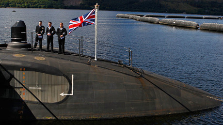 Crew on board HMS Astute stand on the bow during the commissioning ceremony of the Royal Navy submarine at the Clyde Naval Base near Glasgow, Scotland © David Moir