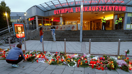 A woman lays flowers in front of the Olympia shopping mall, where yesterday's shooting rampage started, in Munich, Germany July 23, 2016. © Arnd Wiegmann