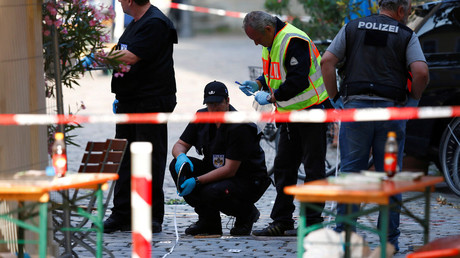 Police secure the area after an explosion in Ansbach, Germany, July 25, 2016. © Michaela Rehle