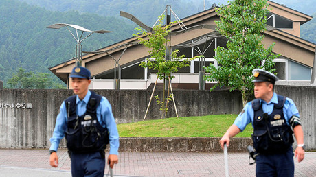 Police officers are seen in front of a facility for the disabled where at least 19 people were killed and as many as 20 wounded by a knife-wielding man, in Sagamihara, Kanagawa prefecture, Japan, in this photo taken by Kyodo July 26, 2016. © Kyodo