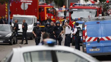 French police officers and fire engine arrive at the scene of a hostage-taking at a church in Saint-Etienne-du-Rouvray, northern France, on July 26, 2016 that left the priest dead. © Charly Triballeau
