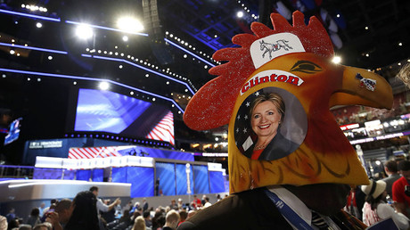 A delegate wearing rooster headgear with a picture of Democratic U.S. presidential candidate Hillary Clinton on the side walks across the floor of the convention during the second night at the Democratic National Convention in Philadelphia, Pennsylvania, U.S., July 26, 2016. © Jim Young