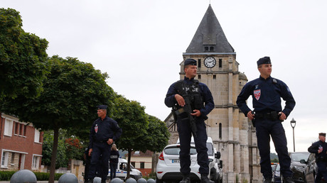 French CRS police stand guard in front of the church a day after a hostage-taking in Saint-Etienne-du-Rouvray near Rouen in Normandy, France © Pascal Rossignol