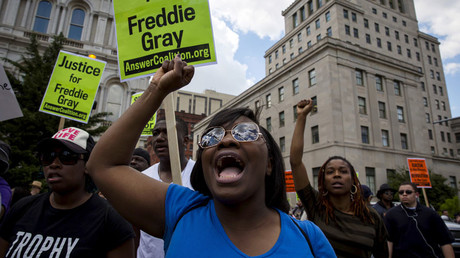 FILE PHOTO: People gather at city hall in Baltimore, Maryland © Eric Thayer