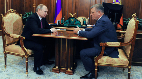 Russian President Vladimir Putin, left, and Head of the Federal Service for State Registration, Cadastre and Cartography Igor Vasilyev meet at the Kremlin. © 