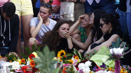 Young women mourning outside the Olympia shopping mall in Munich, Germany July 24, 2016. © Arnd Wiegmann