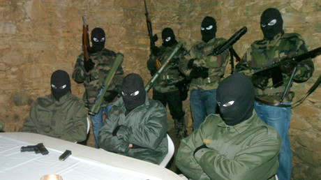 "Masked National Corsican Liberation Front members (FLNC) from the ""October 22"" faction, are seen in this picture taken October 31, 2006 making a clandestine nightime statement in the hills of Corsica. © Pierre Murati"