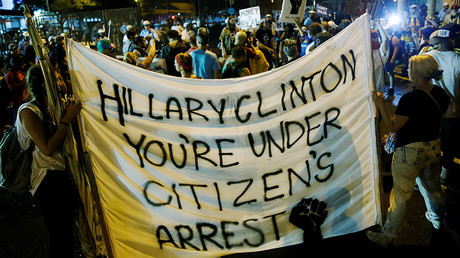 Activists hold a banner against Hillary Clinton amid protest outside the Wells Fargo Center on the final day of the Democratic National Convention in Philadelphia, Pennsylvania, U.S., July 28, 2016 © Dominick Reuter