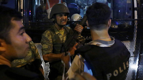 Turkish soldiers surrender their weapons to policemen during an attempted coup in Istanbul's Taksim Square, Turkey, July 16, 2016. © Murad Sezer