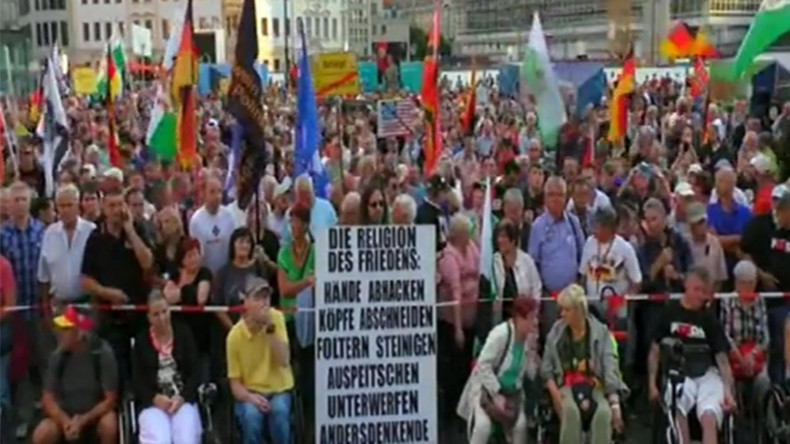 Hundreds join PEGIDA rally in Dresden to protest Berlin's ...  Hundreds join P...