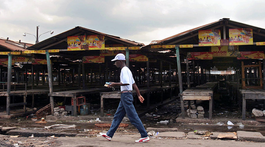 A man walks past empty market stalls in Republic of Congo's capital of Brazzaville. © Jiro Ose