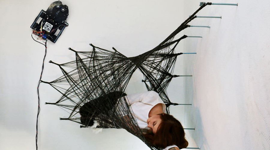 Incredible ceiling-crawler robots weave human wall 'cocoon' (VIDEO)