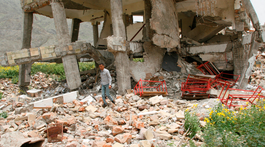 A man walks on the rubble of a school destroyed by a Saudi-led air strike in the southwestern city of Taiz, Yemen July 27, 2016. © Anees Mahyoub