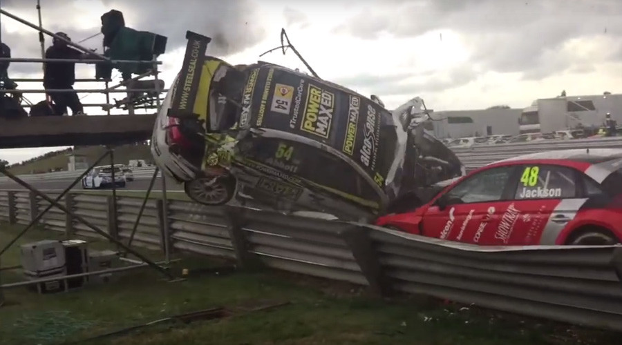 Sportscar plunges into TV camera tower at race (VIDEO)