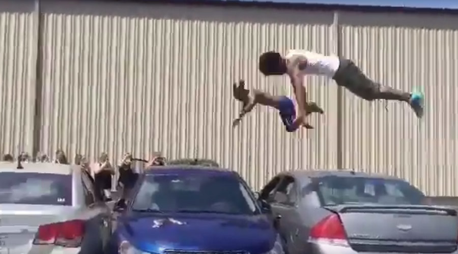 DIY Olympics: Pair of gymnasts trampoline over 3 cars (VIDEO)