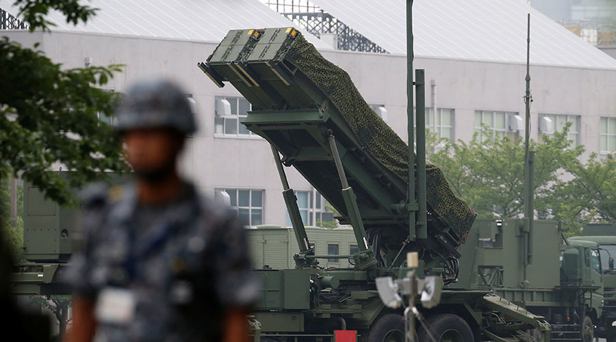 A Japan Self-Defense Forces soldier guards near a unit of Patriot Advanced Capability-3 (PAC-3) missiles at the Defense Ministry in Tokyo, Japan. ©Toru Hanai