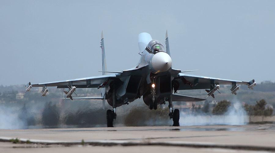A Russian Su-30 aircraft lands at the Hmeimim airbase in Syria. ©Maksim Blinov