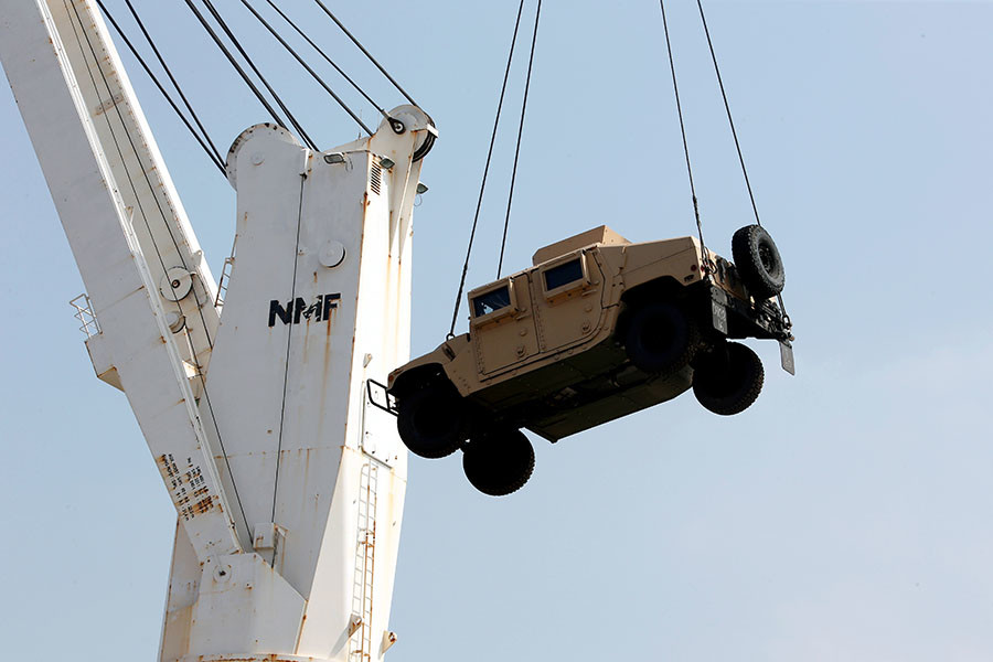 Workers unload a Humvee, part of a military donation from the U.S. government to the Lebanese army, during a ceremony at Beirut's port, Lebanon, August 9, 2016. © Mohamed Azakir