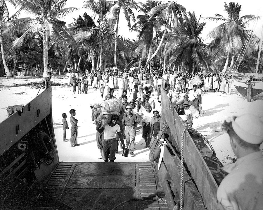 "According to the Navy's caption, ""Natives going aboard LCM [Landing craft mechanized]."" According to the photo this event was in July 1946 but it was probably in late February or early March. © nsarchive.gwu.edu"