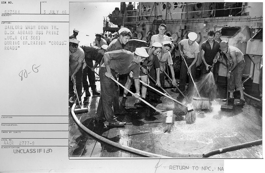 Group of sailors wash down the highly contaminated deck of the captured German battleship USS Prinz Eugene (IX 300) after the Baker explosion. The ship was so radioactive that it was later sunk. © nsarchive.gwu.ed