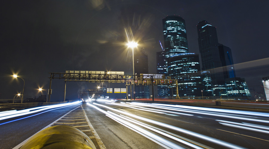 "Cars pass by the Moscow  business district ""Moskva-City"" © Anton Golubev"