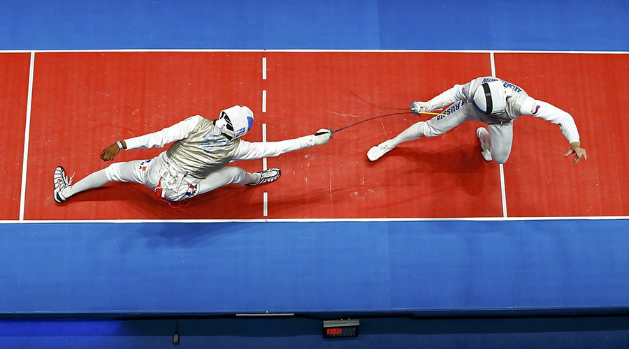 Enzo Lefort (FRA) of France competes with Artur Akhmatkhuzin (RUS) of Russia. © Issei Kato