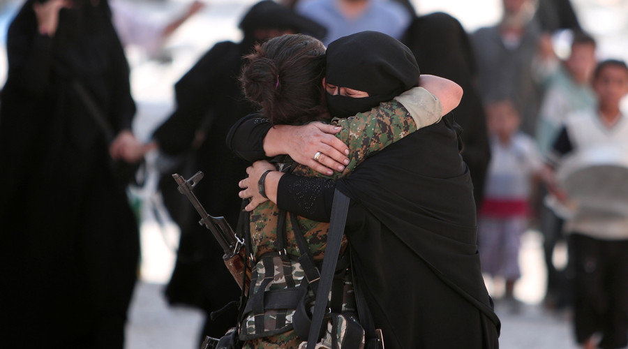 A woman embraces a Syria Democratic Forces (SDF) fighter after she was evacuated with others by the SDF from an Islamic State-controlled neighbourhood of Manbij, in Aleppo Governorate, Syria, August 12, 2016. © Rodi Said