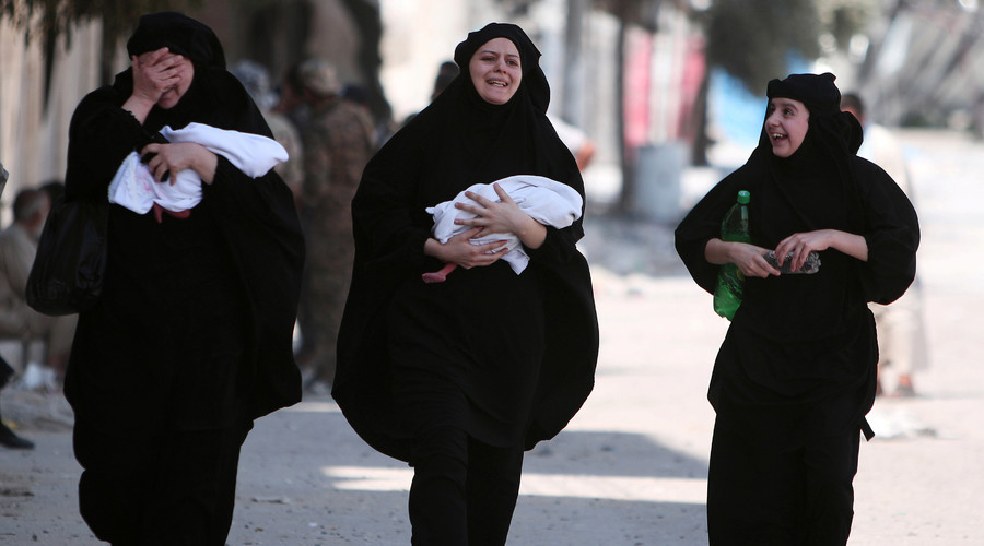 Women carry newborn babies while reacting after they were evacuated by the Syria Democratic Forces (SDF) fighters from an Islamic State-controlled neighbourhood of Manbij, in Aleppo Governorate, Syria, August 12, 2016. © Rodi Said