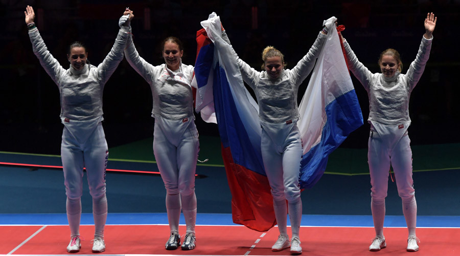 Russian fencers Yana Egorian, Sofya Velikaya, Yulia Gavrilova and Yekaterina Dyachenko celebrate after winning gold in Rio 2016 Olympics women's team saber final. © Grigory Sysoyev